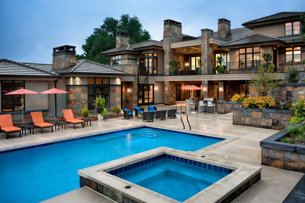 custom home with outdoor pool and hot tub