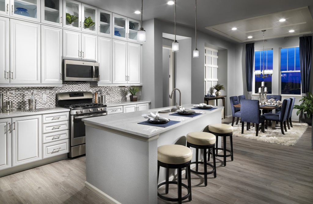 Open kitchen with white cabinets