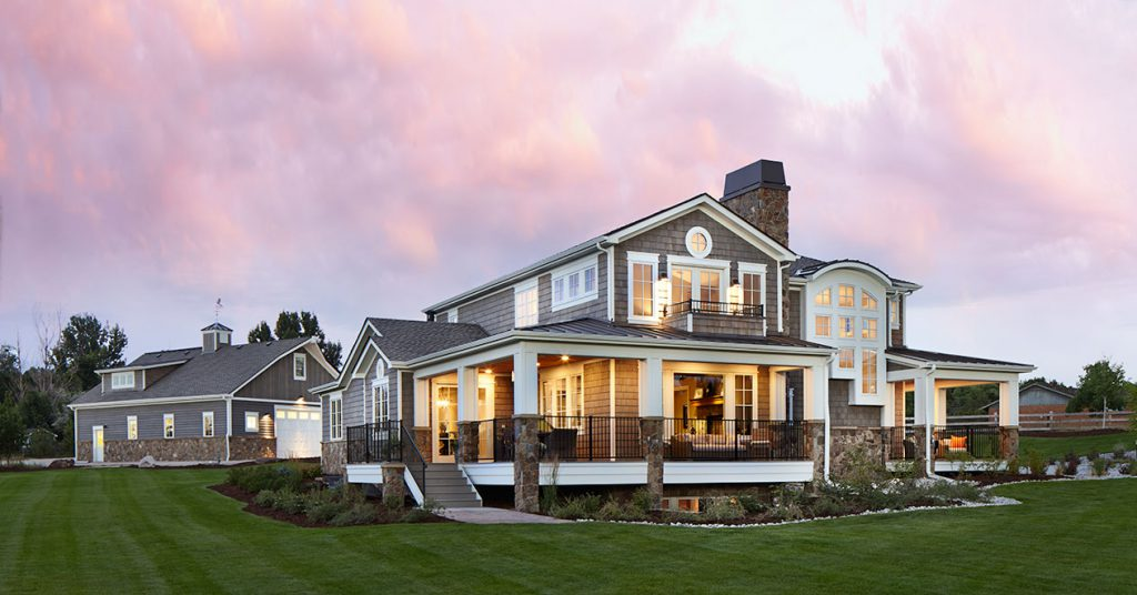 This mountain shingle style home exudes curb appeal with a Colorado twist on a timeless style