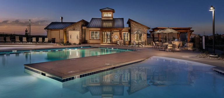 Dusk image of Heirloom Clubhouse and swimming pool