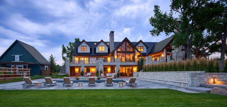 Remodeled modern farmhouse home - view of rear elevation and backyard with swimming pool