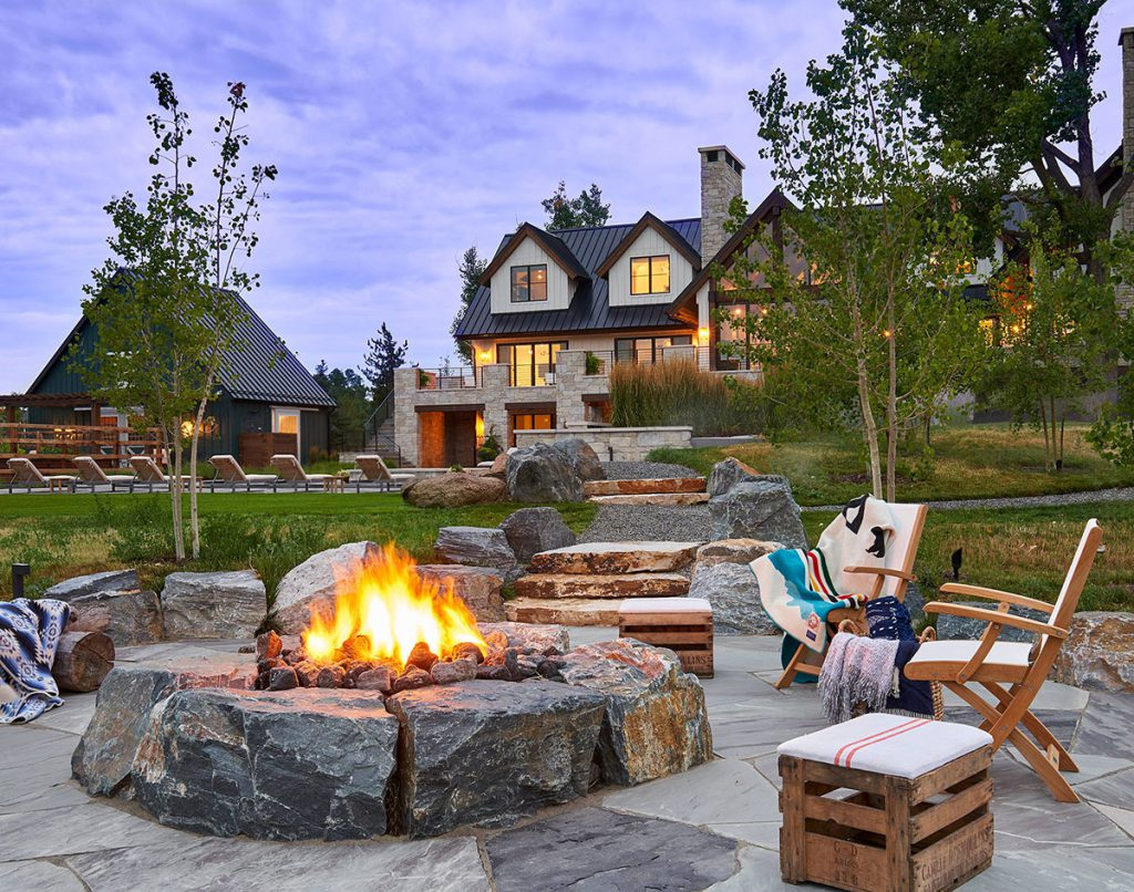 Modern farmhouse remodel with firepit and pool by KGA