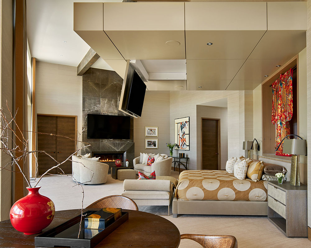 This TV that lowers out of the ceiling is a creative way to incorporate home technology upgrades into your custom home or remodel