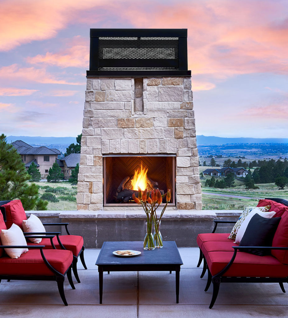 Luxury outdoor living space with built in fireplace