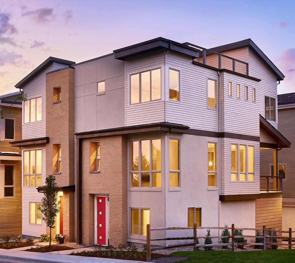 Simple and efficient designs that go vertical instead of horizontal, such as this 3-story paired home, are good cost effective design solutions for home building.