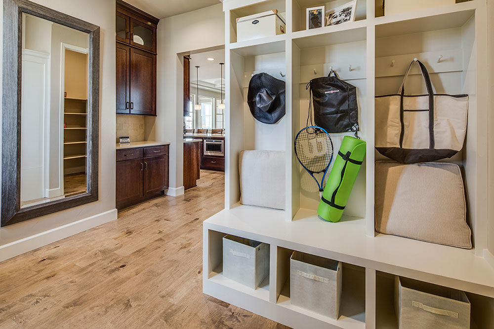 Including a mudroom or owners entry is a good way to promote health and wellness through architecture. These gatekeeper spaces help homeowners stay organized and keep dirt and germs out.